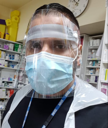 Pharmacist wearing PPE