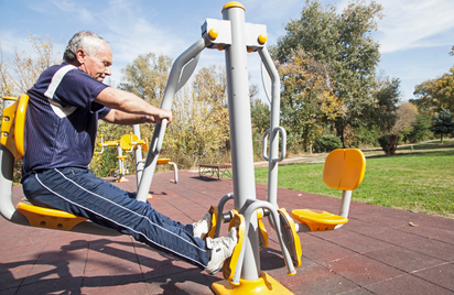 Older man exercising in a park